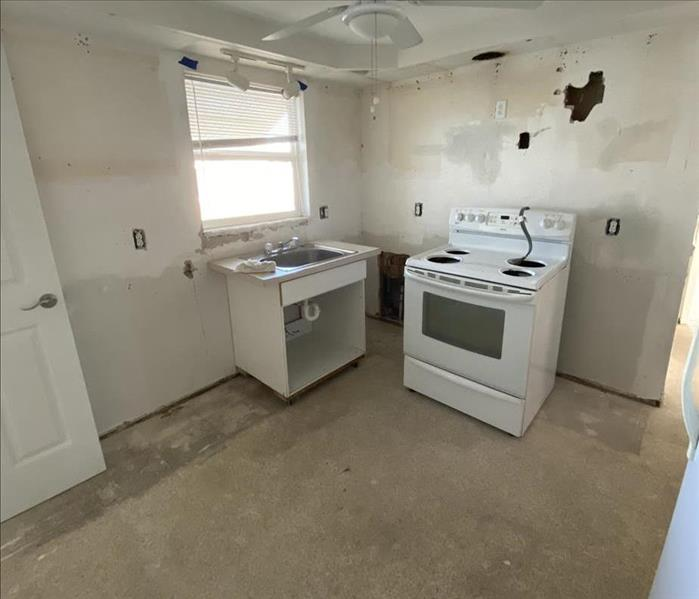 empty kitchen, no cabinets, just oven