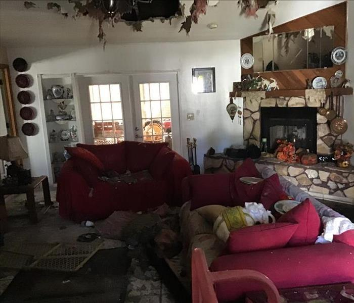 living room covered with debri from fire damage